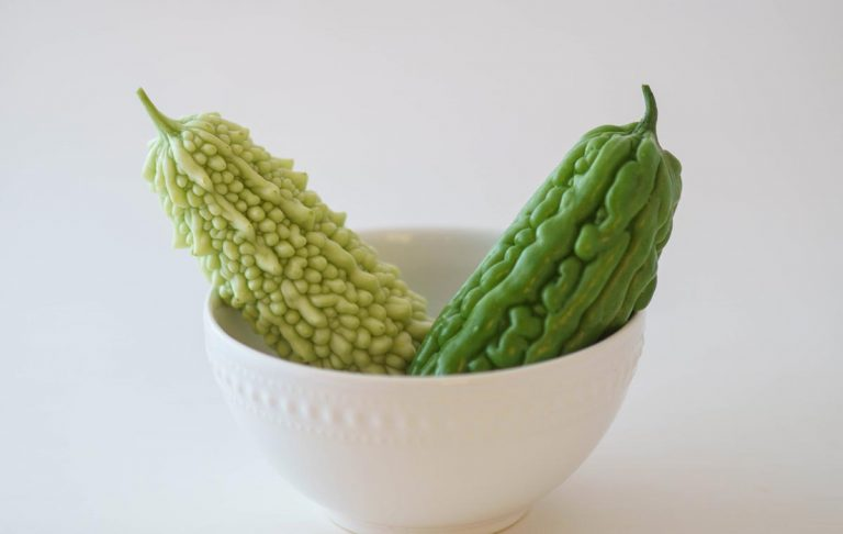 Two varieties of bitter gourds in a bowl