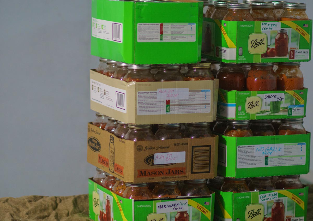 Canned tomatoes stacked together.