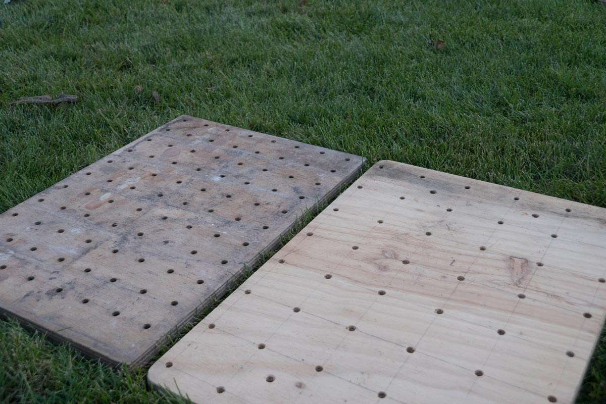 Two templates for seed placement in garden. One with holes 3 inches apart and the other 4 inches apart